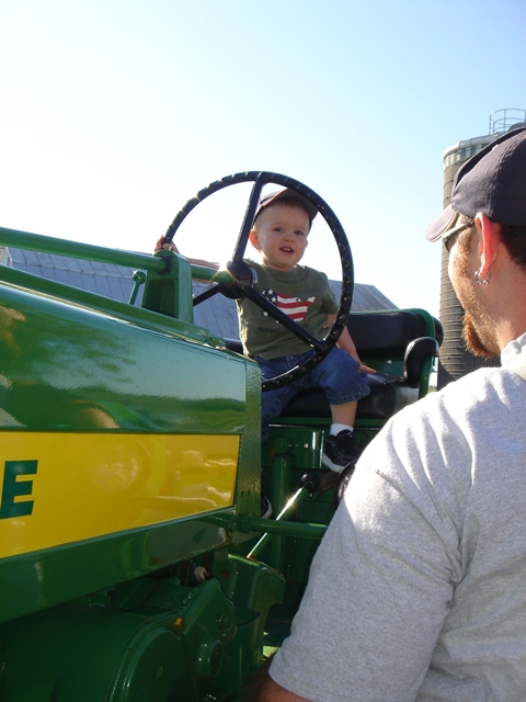Caleb on the tractor from a different angle.