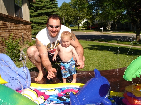 Daddy and Caleb playing in the new pool