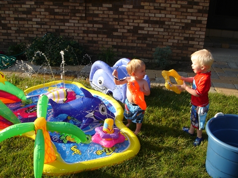 Caleb and his buddy playing in the pool.
