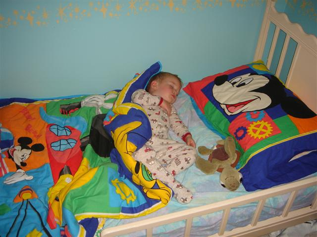 Caleb getting his beauty sleep in his new big boy bed