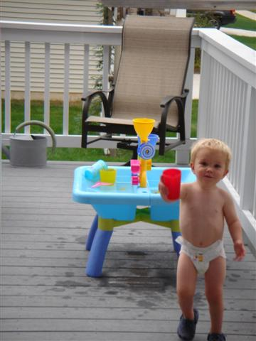 See how much better the water table is than canning applesauce?