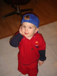 Caleb decided to try on one of his hats...he likes wearing it the way daddy does sometimes...