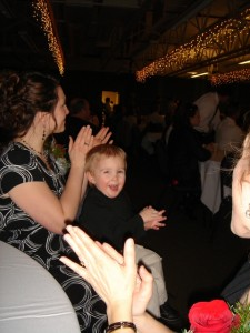 Caleb loved clapping for the wedding party as they entered the reception hall at Erica's wedding...