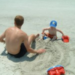 Caleb and Michael Playing on the Beach