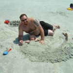 Caleb buried in the sand
